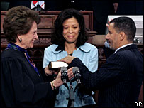 David Paterson (r) is sworn in as New York governor, watched by wife Michelle (c), 17 Mar 2008