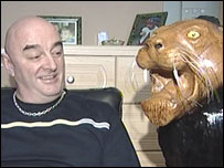 Mr Osbourne with one of his life-sized lions