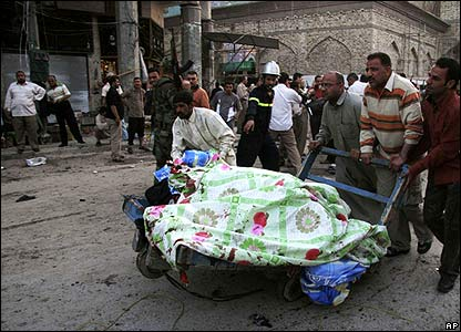 Bodies are wheeled away from the site of the Karbala attack