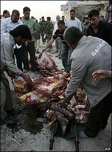 Bodies are collected from the site of the Karbala attack