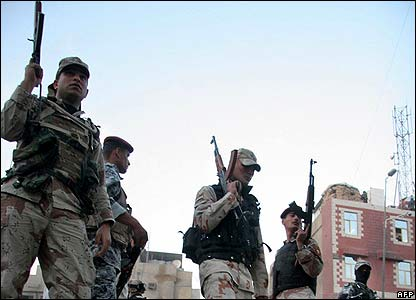 Security forces guard the scene of the attack