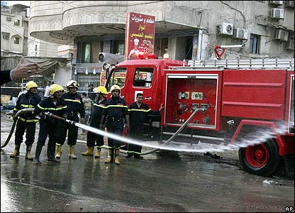 A fire engine hose washes the site of the Karbala blast