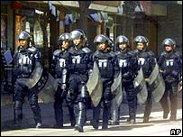 Chinese riot police patrol Tongren in Qinghai, a province bordering Tibet