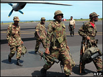 Tanzanian troops arrive on the Comoros island of Moheli on a military transport plane, 12 March, 2008