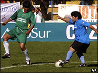Argentine soccer legend Diego Maradona, right, and Bolivia's President Evo Morales in action during a charity soccer match in La Paz, 17 March, 2008