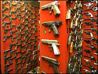Guns line the walls of the firearms reference collection at the Washington Metropolitan Police Department headquarters