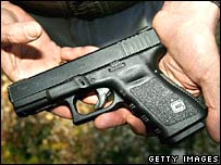 Firearms store owner John Markell holds a Glock 19 handgun April 17, 2007 in Roanoke, Virginia.