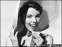 Woman eats chocolate
