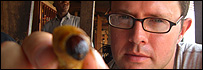 Food writer Stefan Gates holds a palm weevil in Cameroon