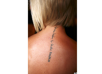 The Hebrew script on Victoria Beckham's upper back reads: 'I am my beloved's