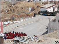 Monks and police face off at the Ganden Monastery, 40km east of Lhasa on 12 March