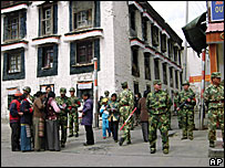 Security officers check IDs of residents in the Tibetan capital of Lhasa Tuesday, March 18, 2008