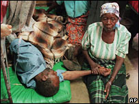 Malawian woman holding a man's hand