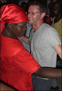 Stefan Gates (L) dancing with a Haitian woman (R)