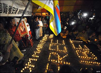 Tibetan protesters hold a candlelight vigil outside the presidential palace in Taipei on Tuesday