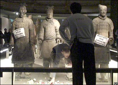 Handout photo dated 18 March of a member of staff talking to a protester inside the Terracotta Army exhibition room at the British Museum, London