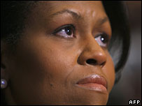 Michelle Obama listens to her husband give a speech on race, 18 Mar 2008