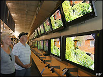 Couple look at televisions in a shop - file photo