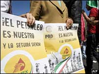 """The oil is ours and will remains so,"" reads a banner carried at the protest in Mexico City on 18 March"
