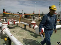A Transredes oil worker walks past a gas pipeline in Bolivia,  Nov 1 2007.