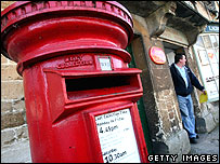 Post box outside Lacock Village Stores and Post Office which is earmarked for closure