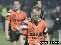 Andrew Henderson walks off the field after Castleford's relegation from Super League in 2006