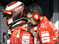 Kimi Raikkonen is consoled by chief engineer Chris Dyer after retiring in Melbourne