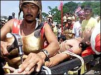 A Filipino is nailed to a cross on Good Friday in 2002