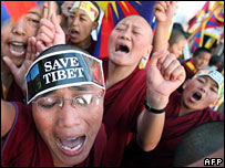 Tibetan Buddhist monks in exile shout anti-China slogans at a protest in Dharamsala, India