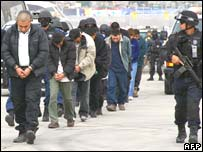 Federal policemen escort alleged members of the criminal gang Cartel del Golfo in Mexico City in January 2008