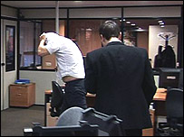 Staff at Newbridge International in Barcelona hide their identity when confronted by Money Programme cameras