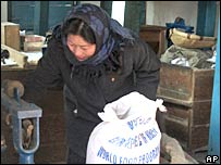 A North Korean woman collects food ration at Public Distribution Center in Sohung County, in North Korea's North Hwanghae