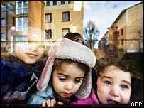 Three Iraqi immigrant children look out of window of day care centre in Sweden, Jan 2008