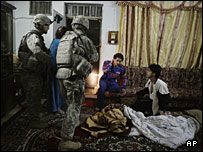 Iraqi men awake to U.S Army soldiers