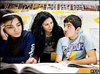 Iraqi refugee children with teacher in Sweden