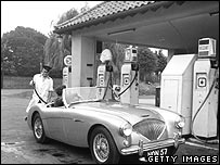 Austin Healey being filled up at a petrol station
