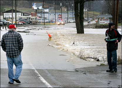 Residents watch rising floodwaters in Miamitown, Ohio