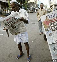 Man reading newspaper in Colombo