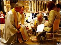 Archbishop of Canterbury performing feet-washing ceremony