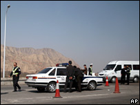 Chinese police set up a road block near Linxia, Gansu province, on 19 March 2008