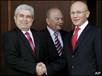 Cypriot President Demetris Christofias (left) and Turkish Cypriot leader Mehmet Ali Talat (right) shake hands