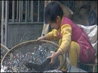 A child sorting e-waste