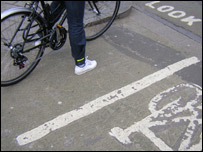 A cyclist waiting on a cycle path