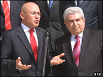 Cypriot President Demetris Christofias (right) and Turkish Cypriot leader Mehmet Ali Talat (left) shake hands