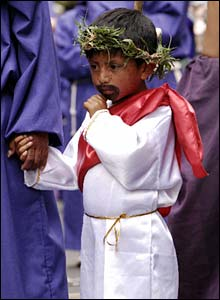 Boy in costume in procession in Quito, Ecuador - photo Adam Blenford