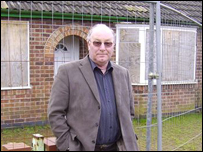 Councillor David Horton outside an unused property