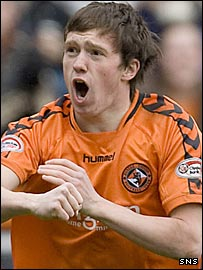 Danny Swanson celebrates scoring against Motherwell