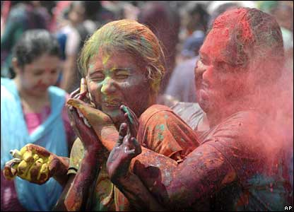 Women smear colours on each other in Ahmadabad, India