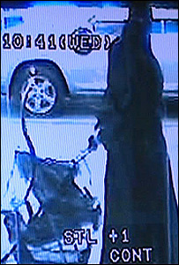 CCTV of the man dressed as a Muslim woman