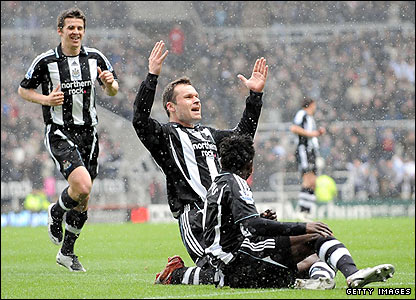 Mark Viduka celebrates scoring for Newcastle
